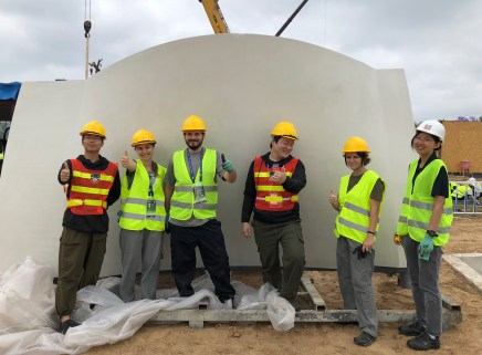 Team WashU celebrates the installation of the first wall panel. From left: Jian Zhu, Kinga Pabjan, John Hampton, Heewoong Yang, Shannon Mallon and Lu Yu.