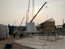 After a slight delay caused by Typhoon Maria, the first wall panel arrives on site.