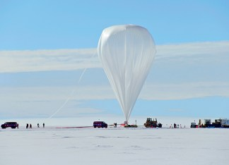 Super-TIGER's launch, Dec. 9, 2012, is seen from a distance. The volume of the balloon on the ground is less than 1 percent of its volume at the float altitude of 120,000 feet. Personnel not considered mission-critical are required to stand well back during a launch. (Ryan Murphy)