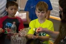 Children doing a physics experiment