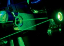 Researchers in the Photosynthetic Antenna Research Center (PARC) probe diverse natural and artificial photosynthetic antenna systems in the PARC Ultrafast Laser Facility in Brauer Hall. (Joe Angeles)