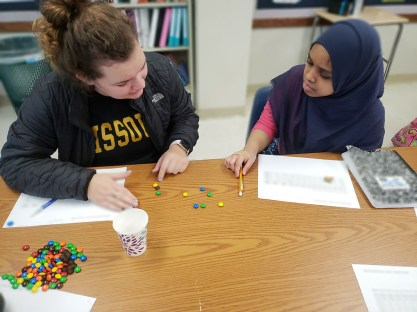 University City High School students use candy to learn how radioactive decay works. The activity was led by members of Catalyst for Change, a Washington University program that exposes female high school students to STEM fields and careers. (Photo courtesy of Gabriela Szteinberg)