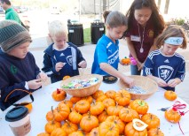 Pumpkin decorating was a popular activity during the Fall Festival. (Jerry Naunheim Jr.)