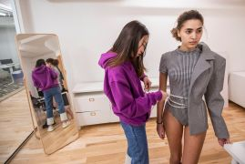 Zhao makes final adjustments to an outfit worn by Liv Hampton of Mother Models. (Photo: Joe Angeles/Washington University)