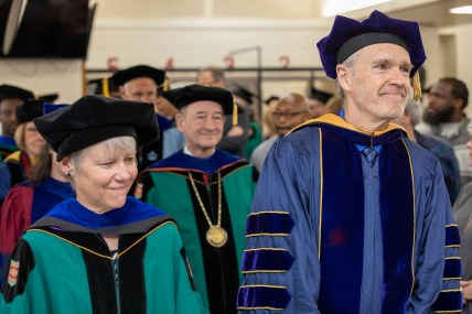 Barbara Baumgartner, associate director of PEP and a teaching professor in Women, Gender & Sexuality Studies in Arts & Sciences; and PEP director Robert Henke, professor of drama and comparative literature in Arts & Sciences, lead the procession.
