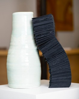 "Lara Head, ""Two vessels,"" 2019. Porcelain, Khadi black rag paper and waxed linen thread."