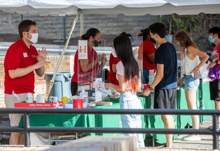 Returning students get tested for COVID-19 at West Campus. (Photo: Joe Angeles/Washington University)