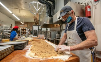 Kevin Turnbull prepares cinnamon rolls, one of the signature baked goods available at Bridge Bread, located at 2639 Cherokee St.