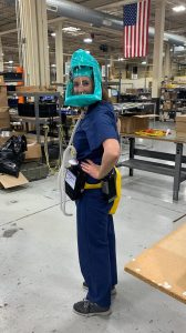 Jennifer DeLaney, MD '97, models version 2 of the powered air-purifying respirator at Hunter Engineering, which provided numerous volunteer hours to help DeLaney develop and build the prototype and manufacture the units. (Courtesy photo)