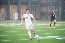 Nolan Wolf passes the ball in the rain during the men's soccer match Sept. 4 between Rose-Hulman and the Bears at the Field House. WashU won 1-0. (Photo: Danny Reise/Washington University)