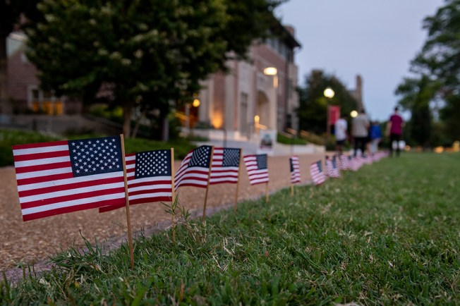 In commemoration of the 20th anniversary of 9/11, members of the College Republicans planted 2,977 flags — one for each victim of the deadly attacks — on Mudd Field. President Nick Rodriguez said annual tradition is a tribute to the lives lost and a call for unity. (Photo: Sid Hastings/Washington University)