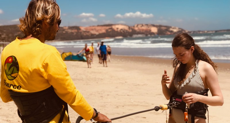 kitesurfing student learning about safety with instructor