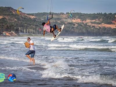 kitesurfer high fives mc on the beach