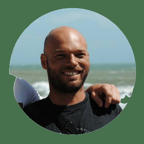 kitesurf instructor smiling on the beach