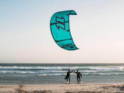 kitesurfers high five with north orbit kite