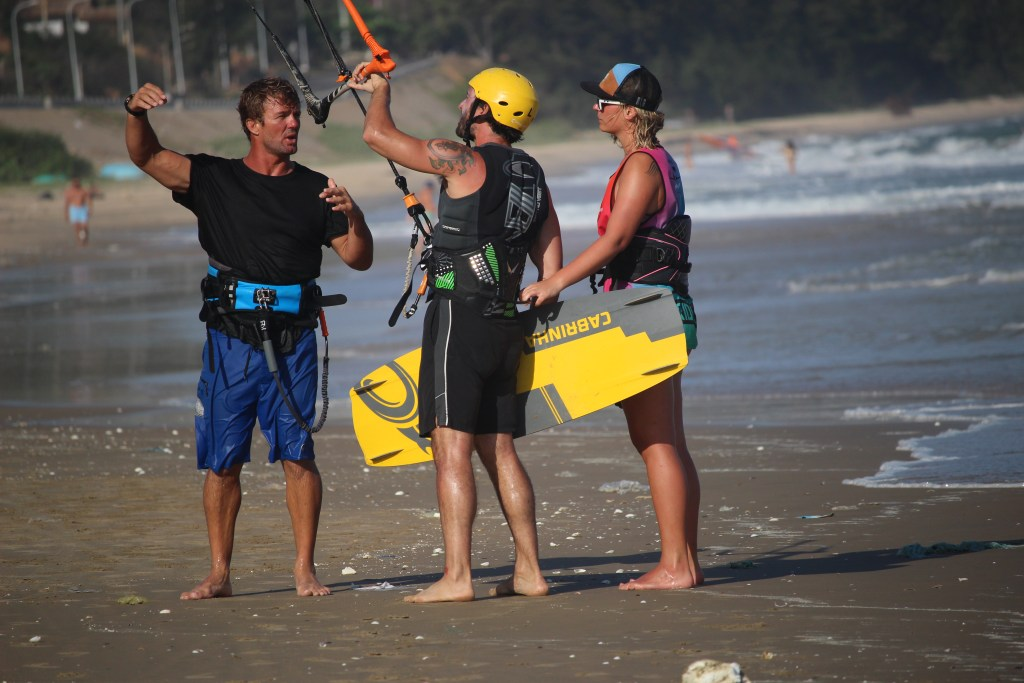 beginner student in a kitesurf lesson with instructor