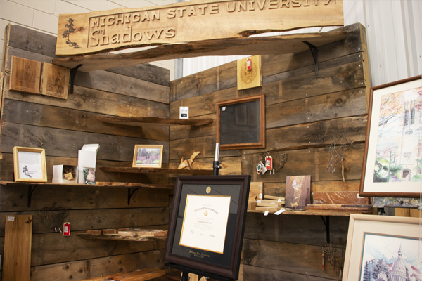 MSU Shadows corner with wood art, wall decor and degree frames.