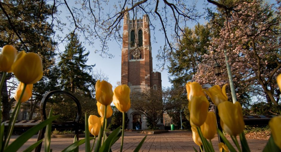 flowers, trees and the Beaumont Tower at MSU.