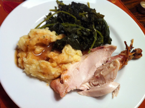 Roast chicken and mashed potatoes with kale