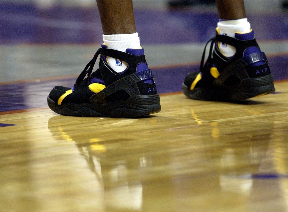 Los Angeles Lakers' Kobe Bryant wears his new Nike sneakers against the Phoenix Suns at America West Arena in Phoenix. Bryant wore Adidas until the start of the 2003-2004 season.