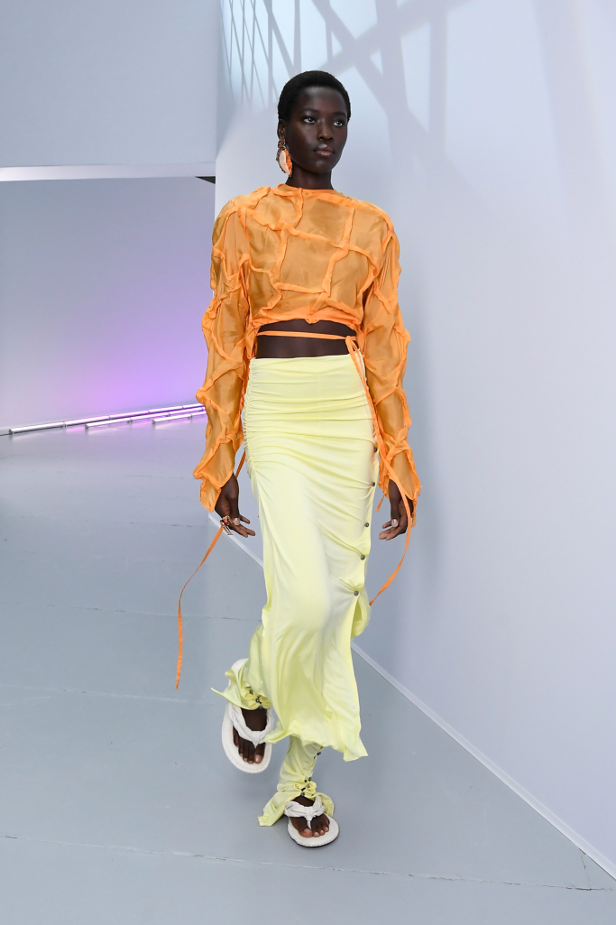 From baggy jeans to bra tops, Lyst named the spring fashion and color trends on track to shape the season.