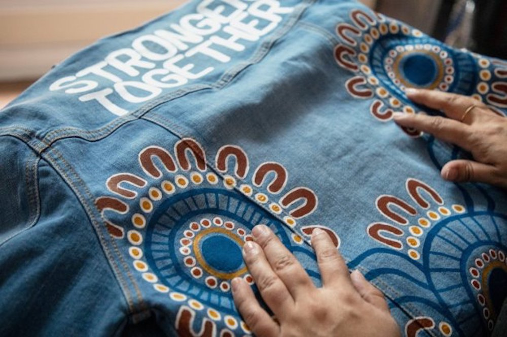 Outland Denim collaborated with indigenous artist Regina Jones on a collection of T-shirts and tote bags featuring feminist artwork.