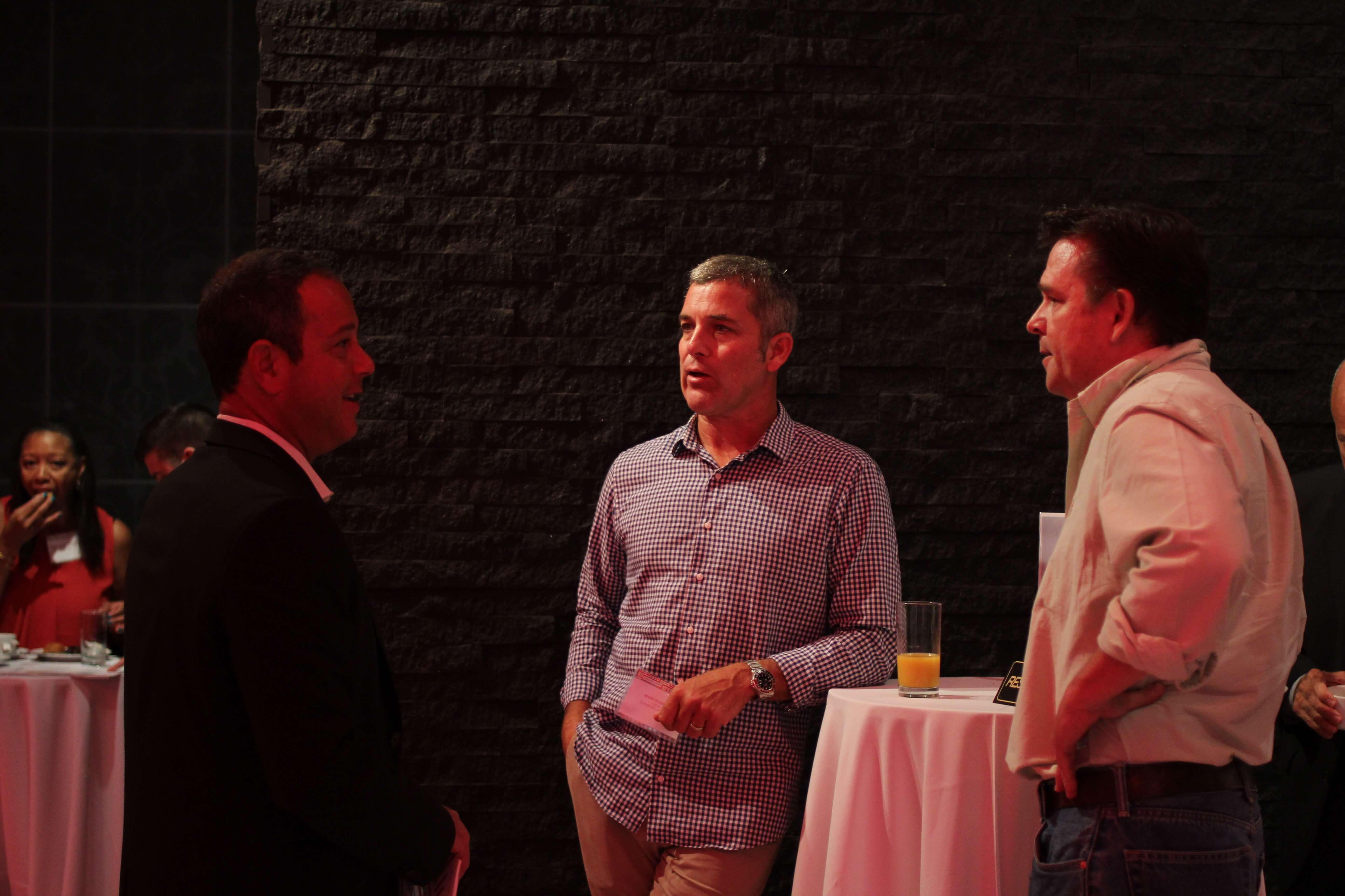 Three men chatting