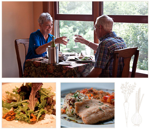 A couple toasts each other over a delicious dinner at Sourwood
