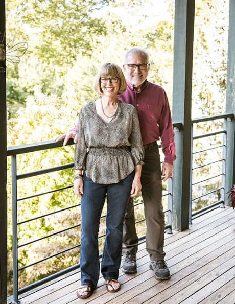 Connie and Proal stand on the back deck of Sourwood Inn