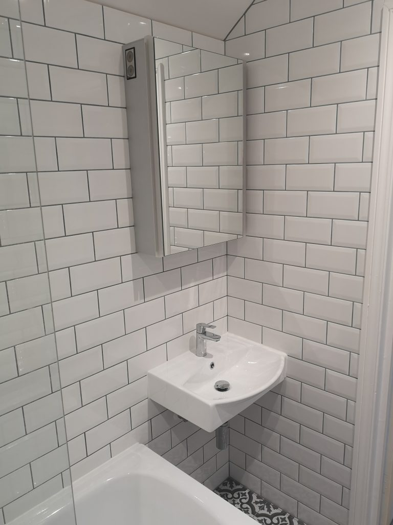 Bathroom With White Metro Tiles And Grey Grout
