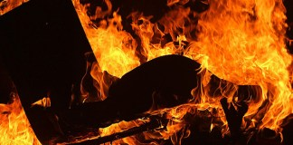 Man (75) found hanging after he burns wife to death in hut