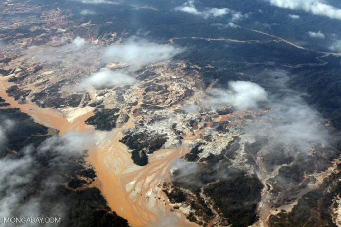Devastation wrought by an open pit gold mine in the Peruvian Amazon. Photo by Rhett Butler.