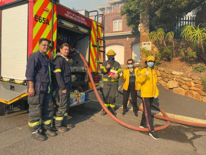Scientology Volunteer Ministers assist firefighters during Cape Town runaway fires