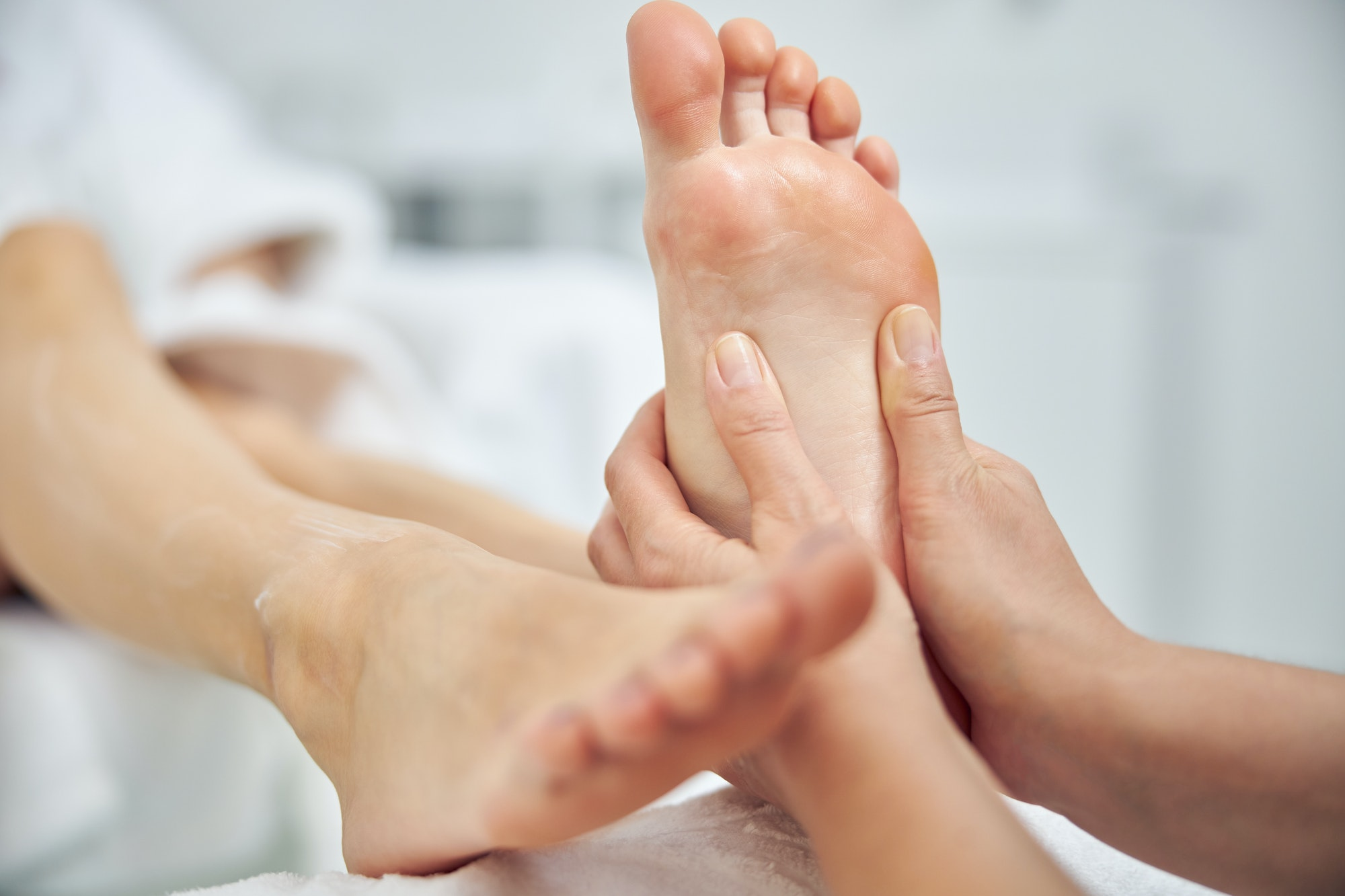 Woman having feet treated in spa salon