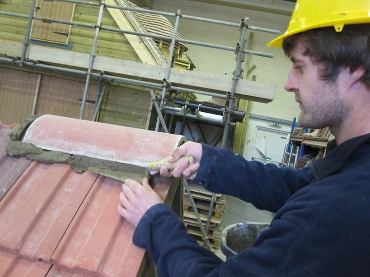 Laying a ridge on interlocking tiles