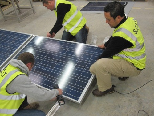 Assembling solar panels to flat-roof frame