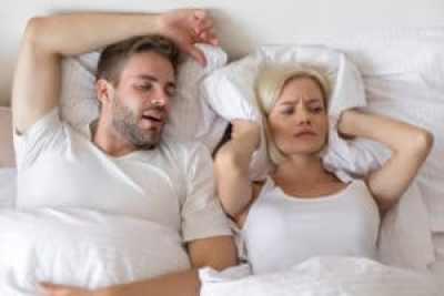 man with sleep apnea keeping his partner awake from snoring
