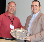 Cotton Board Chairman, Aaron Barcellos, presents a silver plate to outgoing Chairman, David Grant