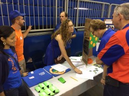 Club leader Katie Rogers Greeting visitors at the UF CALS Citrus Club exhibit before Saturday's game in Gainesville.