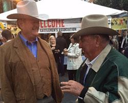Former FL Commissioner of Agriculture Charles Bronson (left) visits with rancher Billy Kempfer