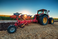 farmer-in-tractor-preparing-land-with-cultivator