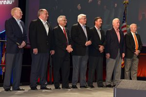 Federation President Jimmy Parnell, second from left, accepts Awards of Excellence and President's Awards during the Farm Bureau Annual Meeting.
