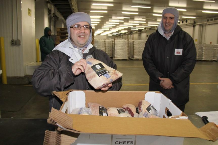Consul General Ricardo Zuniga displays U.S. beef ready for Brazilian customers representing more than a decade of work.