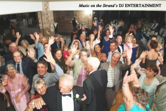 The Myrtle Beach DJ plays the first dance song to a packed floor!
