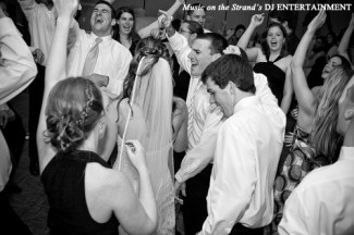 During an open dancing segment of a Myrtle Beach wedding, the DJ brings in a requested song at just the right time.