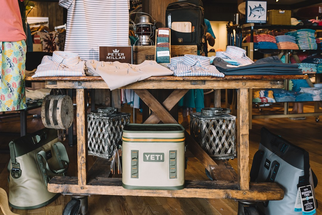 A store display featuring men's clothing and a YETI cooler.