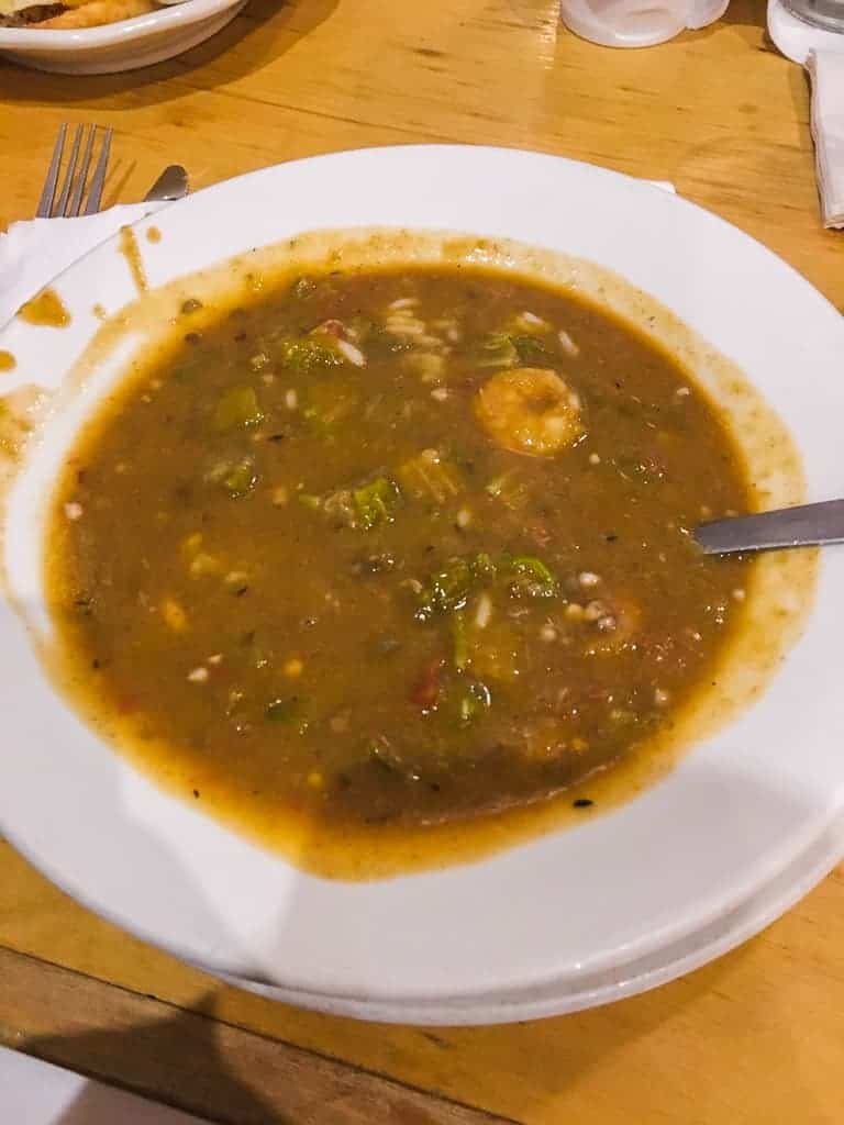 A white bowl filled with seafood gumbo.