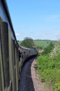 35006 pulls away from Cheltenham Racecourse in the sunshine