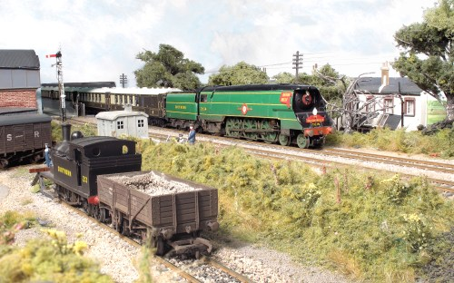 Bulleid Merchant Navy class 21C14 'Nederland Line' built from a Millholme kit, heads to London with the up Devon Belle having taken over the train at Wilton. Adams O2 built from a Wills kit, shunts the ash wagon on shed. My Grandfather, a Ganger,  can be seen taking a break leaning on his ballast fork near the platelayers hut.