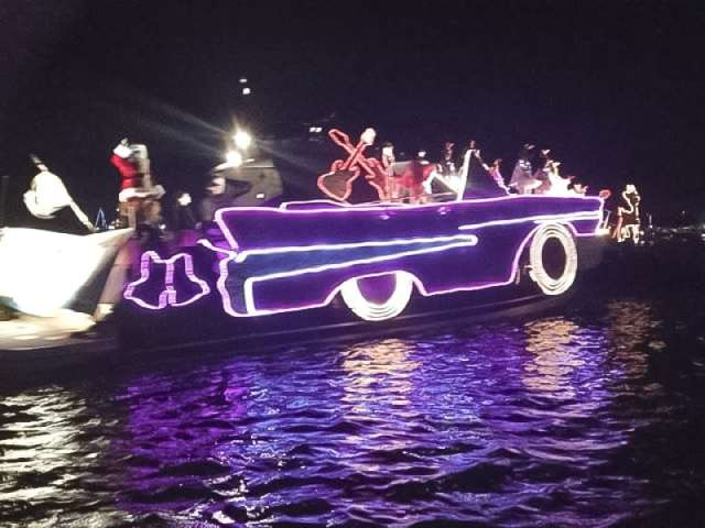 Channel Islands Harbor (CA) Parade of Lights The Yacht Club at Channel Islands harbor (TYC) entry. 50ft long Pink Cadillac. 8 dancers dressed as reindeer on the bow and jingle bell rock playing.